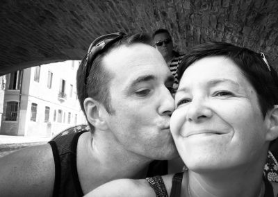 Sneaking in a kiss under a Venetian bridge